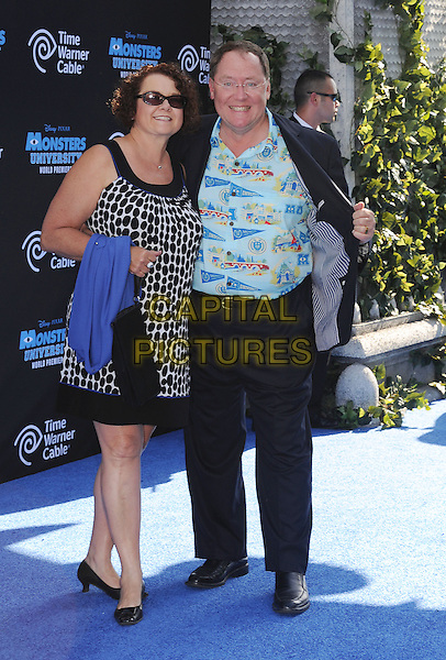Nancy Lasseter, John Lasseter<br /> &quot;Monsters University&quot; Los Angeles Premiere held at the El Capitan Theatre, Hollywood, California, USA.<br /> June 17th, 2013<br /> full length blue white glasses shirt black white print dress sunglasses trousers shades married husband wife<br /> CAP/ROT/TM<br /> &copy;Tony Michaels/Roth Stock/Capital Pictures