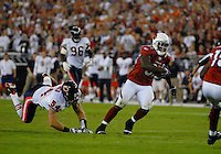 Oct. 16, 2006; Glendale, AZ, USA; Arizona Cardinals wide reciever (81) Anquan Boldin runs past a diving Chicago Bears linebacker (54) Brian Urlacher at University of Phoenix Stadium in Glendale, AZ. Mandatory Credit: Mark J. Rebilas