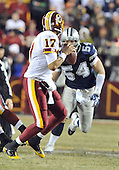 Landover, MD - December 27, 2009 -- Dallas Cowboys linebacker Bobby Carpenter (54) rushed Washington Redskins quarterback Jason Campbell (17) in game action at FedEx Field in Landover, Maryland on Sunday, December 27, 2009..Credit: Ron Sachs / CNP.(RESTRICTION: NO New York or New Jersey Newspapers or newspapers within a 75 mile radius of New York City)