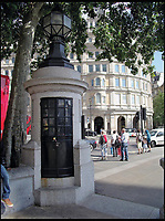 BNPS.co.uk (01202 558833)<br /> Pic: AmberleyPublishing/BNPS<br /> <br /> The 1928 police box located within a stone pillar at Trafalgar Square, London.<br /> <br /> The iconic British phonebox has been given a ringing endorsement in a new book charting the expiring institution's fascinating history. <br /> <br /> Aptly titled 'The British Phonebox', the book primarily focuses on the ubiquitous design that's as emblematic to Britain as the black cab, double decker bus and Houses of Parliament. <br /> <br /> Equally interesting are the early chapters, which detail the phonebox's humble 19th century beginnings and the final ones, that bemoan their dwindling numbers <br /> <br /> The 96 page paperback, jointly authored by friends Nigel Linge and Andy Sutton, is published by Amberley and costs &pound;13.49.