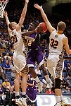 SIOUX FALLS, SD - MARCH 9:  Jason Hawthorne #12 from Western Illinois takes the ball to the basket between Connor Devine #30 and Marcus Heemstra #32 from South Dakota State University in the second half of their quarterfinal game at the 2014 Summit League Tournament Sunday evening in Sioux Falls, SD. (Photo by Dave Eggen/Inertia)