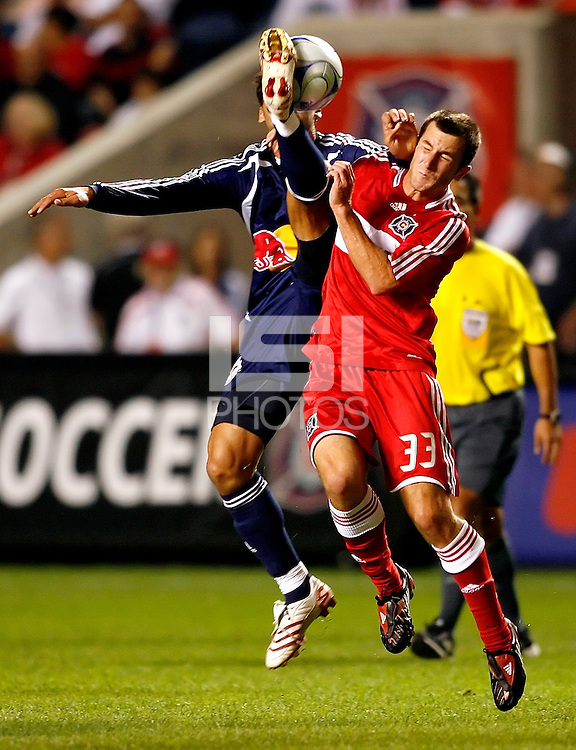 New York defender Gabriel Cichero (17) gets called for a dangerous play against Chicago Fire midfielder Stephen King (33).  The Chicago Fire defeated the New York Red Bulls 1-0 at Toyota Park in Bridgeview, IL on September 6, 2008.