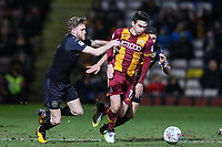 Alex Gilliead of Bradford City gets away from the Wigan defence during the Sky Bet League 1 match between Bradford City and Wigan Athletic at the Northern Commercial Stadium, Bradford, England on 14 March 2018. Photo by Thomas Gadd.