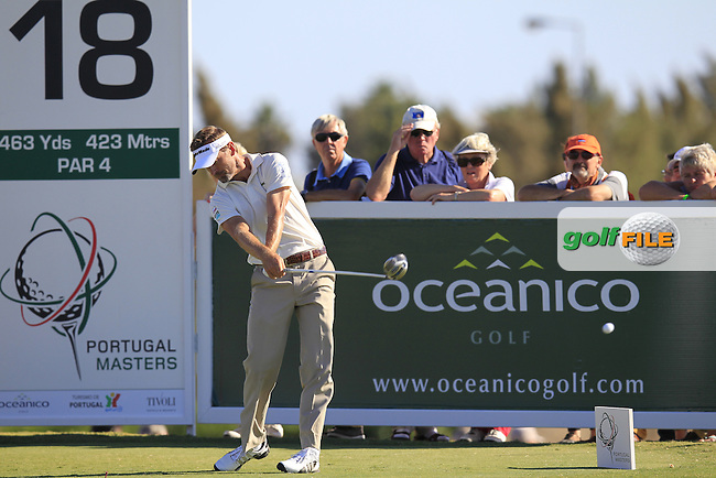 Raphael Jacquelin (FRA) tees off the 18th tee during Sunday's Final Round of the 2013 Portugal Masters held at the Oceanico Victoria Golf Club. 13th October 2013.<br /> Picture: Eoin Clarke/www.golffile.ie