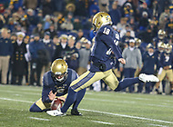 Annapolis, MD - November 11, 2017: Navy Midshipmen place kicker J.R. Osborn (18) kicks the game winning kick during the game between SMU and Navy at  Navy-Marine Corps Memorial Stadium in Annapolis, MD.   (Photo by Elliott Brown/Media Images International)