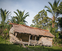 A simple jungle school for the Mentawai children in the village of Buttui. It was built by a Christian missionary. The Mentawai are the tribes living traditionally in the island of Siberut, Indonesia. Here, where the changes came slow, some of the people are still living like their ancestors did centuries ago. They s till practice ancient religion called Arat Sabulungan, which believe that everything in the forest has a spirit.
