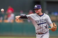New Orleans Zephyrs second baseman Taylor Harbin (4) throws to home during the Pacific League game at the Chickasaw Bricktown Ballpark against the Oklahoma City RedHawks on April 13, 2014 in Oklahoma City, Oklahoma.  The RedHawks defeated the Zephyrs 4-3.  (William Purnell/Four Seam Images)