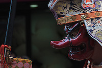 A priest wearing a demon mask during the Kanamara festival for the steel phallus in Kawasaki Daishi, Kanagawa, Japan. Sunday April 5th 2015 The Kanamara penis festival celebrates a legend about the defeat of a penis-eating demon. It is a wildly popular festival attracting large numbers of locals and foreigners.