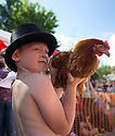 06/08/16<br /> <br /> ***WITH VIDEO***<br /> <br /> Brody Wordsworth, 6,  holds his hen before the start of the first heat..<br /> <br /> Crowds cheer on hens as they compete at the World Hen Racing Championship outside the Barley Mow pub in Bonsall near Matlock Bath, in the Derbyshire Peak District.<br /> <br /> All Rights Reserved, F Stop Press Ltd. +44 (0)1773 550665