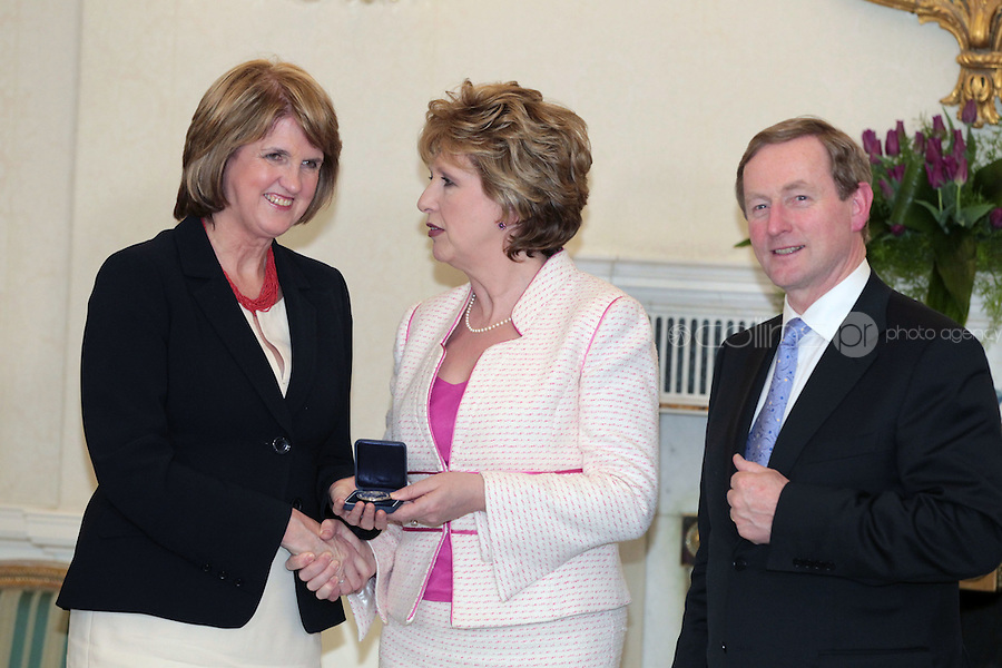 9/3/11 Joan Burton, Minister for Social Protection withPresident Mary McAleese and Taoiseach Enda Kenny at Aras An Uachtarain for the appoinment of the Government. Pictures:Arthur Carron/Collins