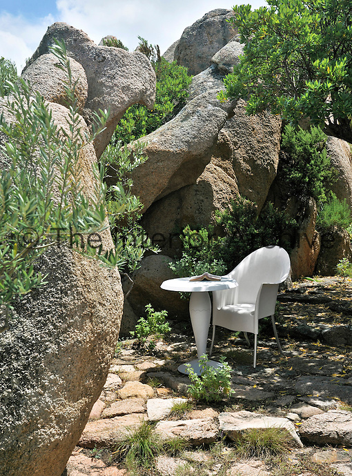 Massive granite boulders form a natural enclosure around a small patio
