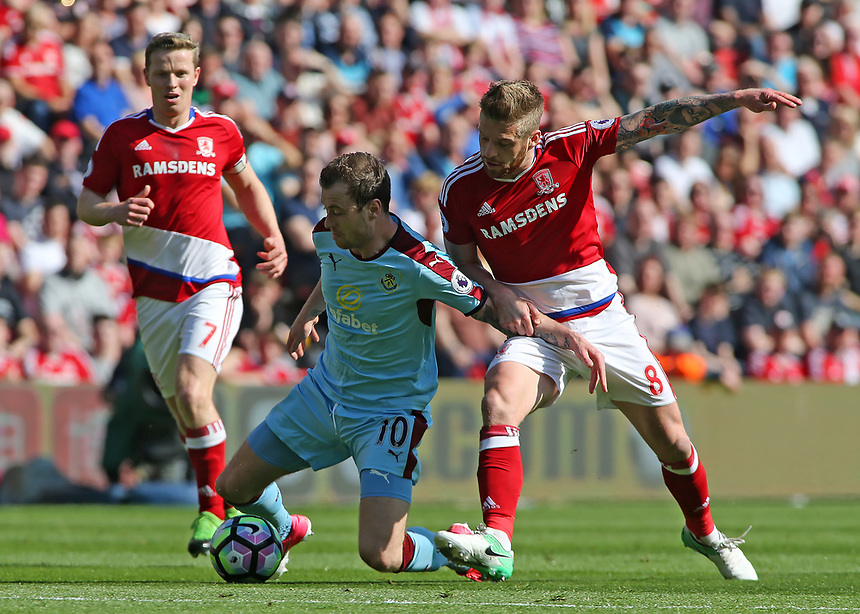 Burnley's Ashley Barnes battles with Middlesbrough's Adam Clayton<br /> <br /> Photographer David Shipman/CameraSport<br /> <br /> The Premier League - Middlesbrough v Burnley - Saturday 8th April 2017 - Riverside Stadium - Middlesbrough<br /> <br /> World Copyright &copy; 2017 CameraSport. All rights reserved. 43 Linden Ave. Countesthorpe. Leicester. England. LE8 5PG - Tel: +44 (0) 116 277 4147 - admin@camerasport.com - www.camerasport.com