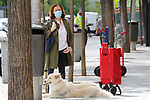 A neighbor from Madrid goes to the purchase accompanied by her dog during the health crisis due to the Covid-19 virus pandemic - Coronaviruss. April 30,2020. (ALTERPHOTOS/Alejandro de Dios)