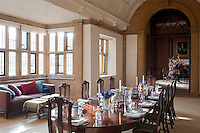 The dining room, added to the building in the 1920s by Sir Edwin Lutyens, is in the Elizabethan style. The varnished wood of the dining furniture creates a stylistic tie with the wooden panelling and antique furniture in the adjoining ante-room