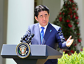 Prime Minister Shinzo Abe of Japan conducts a joint press conference with United States President Barack Obama in the Rose Garden of the White House in Washington, D.C. on Tuesday, April 28, 2015.<br /> Credit: Ron Sachs / CNP