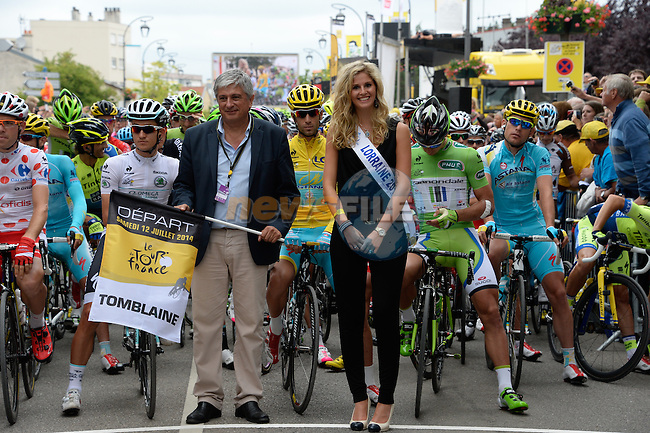 Mayor of Tomblaine Herve Feron and Miss Lorraine, ready to start the stagein front of Polka Dot Cyril Lemoine (FRA) Cofidis, White Michal Kwiatowski (POL) Omega Pharma-Quick Step, Yellow Vincenzo Nibali (ITA) Astana and Green Peter Sagan (SVK) Cannondale, Stage 8 of the 2014 Tour de France running 161km from Tomblaine to Gerardmer La Mauselaine. 12th July 2014.<br /> Photo ASO/B.Bade/www.newsfile.ie