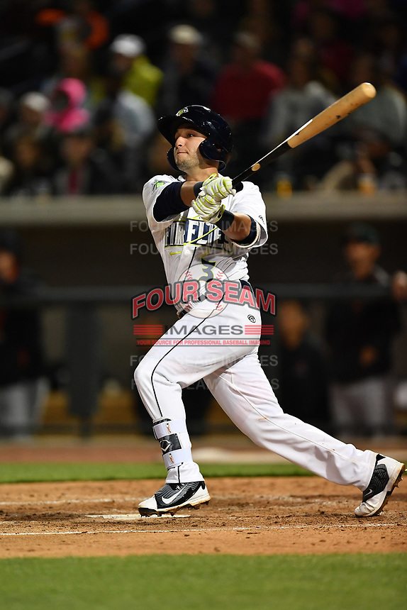 Shortstop Michael Paez (3) of the Columbia Fireflies hits a home run in a game against the Augusta GreenJackets on Opening Day, Thursday, April 6, 2017, at Spirit Communications Park in Columbia, South Carolina. (Tom Priddy/Four Seam Images)