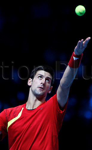 LONDON, Nov. 28, 2009. Novak Djokovic of Serbia serves the ball against Rafael Nadal of Spain during their ATP World Tour Finals Group B Singles third round match in London, O2 Arena, Nov. 27, 2009. Djokovic won 2-0. Photo by Tang Shi/actionplus UK Licenses Only