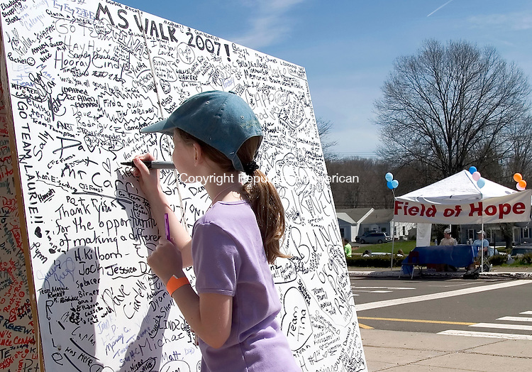 CHESHIRE, CT- 22 APRIL 07- 042207JT01- <br /> Nine-year-old Tess Borsecnik of Granby signs the board at the MS Walk at Cheshire High School on Sunday. Borsecnik has attended the walk every year of her life as part of the &quot;Birney Bunch&quot; Walk Team for Liz Birney, a childhood friend of Borsecnik's mother.<br /> Josalee Thrift Republican-American