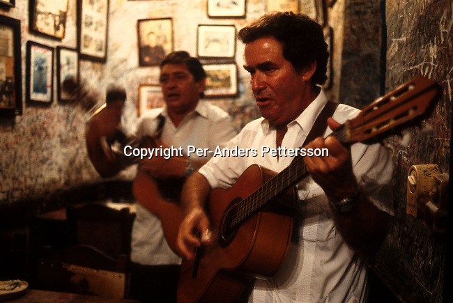 Unidentified men performing for tourists on July 4, 1993 at La Bodegita De Medio, a favorite restaurant for Ernest Hemingway while he lived in Havana, in central Havana, Cuba. President Fidel Castro has ruled the communist island for over 4 decades and been in war of words with the United States all since then. They country has a good eduacation and medical level but lacks freedom of the press and speech. .(Photo: Per-Anders Pettersson/ Getty Images)
