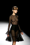 MADRID, SPAIN - FEBRUARY 04: A model walks the runway in the Juanjo Oliva fashion show during the Mercedes-Benz Fashion Week Madrid Autumn/Winter 2012 at Ifema on February 4, 2012 in Madrid, Spain. (Photo by Juan Naharro Gimenez)
