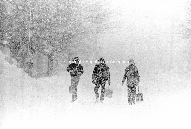 February 6, 1978: BLIZZARD OF '78-  People make their way along Highland Avenue in Waterbury armed with snow shovels during the Blizzard of '78.  Tom Kabelka Photo