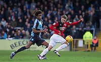 Gwion Edwards of Crawley Town turns Sido Jombati of Wycombe Wanderers during the Sky Bet League 2 match between Wycombe Wanderers and Crawley Town at Adams Park, High Wycombe, England on 28 December 2015. Photo by Andy Rowland / PRiME Media Images