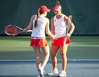 STANFORD, CA - January 26, 2011: Nicole Gibbs and Kristie Ahn of Stanford women's tennis during their match against UC Davis' Koehly/Zamudio. Ahn/Gibbs won 8-1.