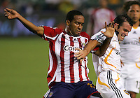 Chivas forward Maykel Galindo (11) battles LA Galaxy defender Chris Klein (7). CD Chivas USA defeated the LA Galaxy 3-0 in the Super Classico MLS match at the Home Depot Center in Carson, California, Thursday, August 23, 2007.