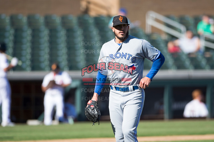 Surprise Saguaros starting pitcher Shawn Morimando (53), of the Toronto Blue Jays organization, walks off the field between innings of an Arizona Fall League game against the Salt River Rafters at Salt River Fields at Talking Stick on November 5, 2018 in Scottsdale, Arizona. Salt River defeated Surprise 4-3 . (Zachary Lucy/Four Seam Images)