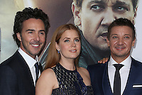 "Westwood, CA - NOVEMBER 06: Shawn Levy, Amy Adams, Jeremy Renner at Premiere Of Paramount Pictures' ""Arrival"" At Regency Village Theatre, California on November 06, 2016. Credit: Faye Sadou/MediaPunch"