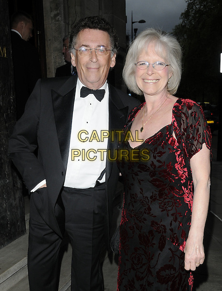 ROBERT POWELL & BARBARA POWELL.At the Sparks Tribute Gala, Grosvenor House Hotel, London, England, UK, .May 7th 2010..half length black tuxedo tux bow tie married couple husband wife red patterned pattern dress glasses .CAP/CAN.©Can Nguyen/Capital Pictures.