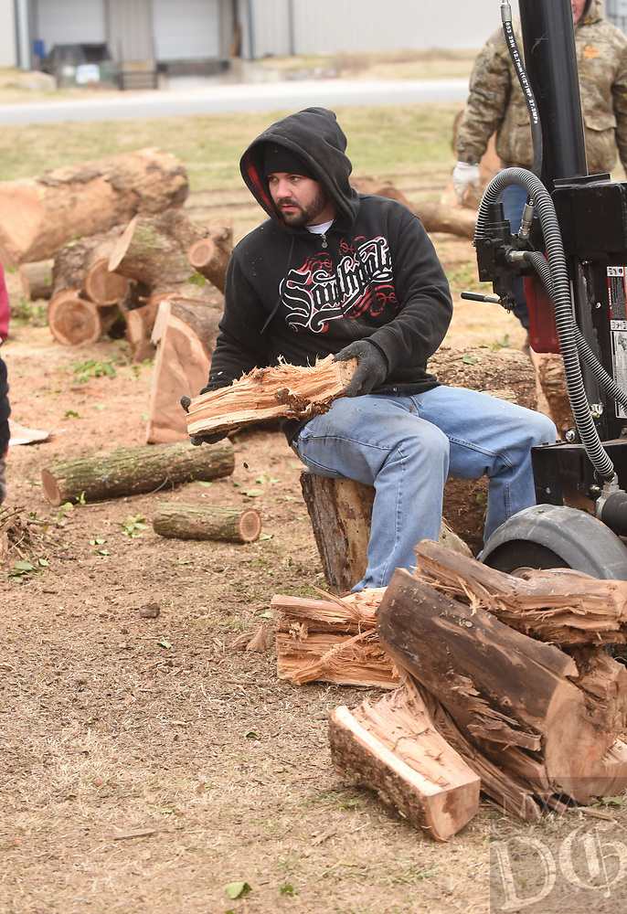 NWA Democrat-Gazette/FLIP PUTTHOFF<br /> HOT COMMODITY<br /> Colton Patrick runs a wood splitter on Saturday Dec. 30 2017 at Soul's Harbor in Rogers. Cox worked with a crew cutting and splitting firewood, which is available for purchase at Soul's Harbor, 1206 N. Second St. Firewood sales have been brisk this winter, workers said.