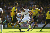 Gylfi Sigurosson of Swansea battles with Almen Abdi of Watford   during the Barclays Premier League match Watford and Swansea   played at Vicarage Road Stadium , Watford