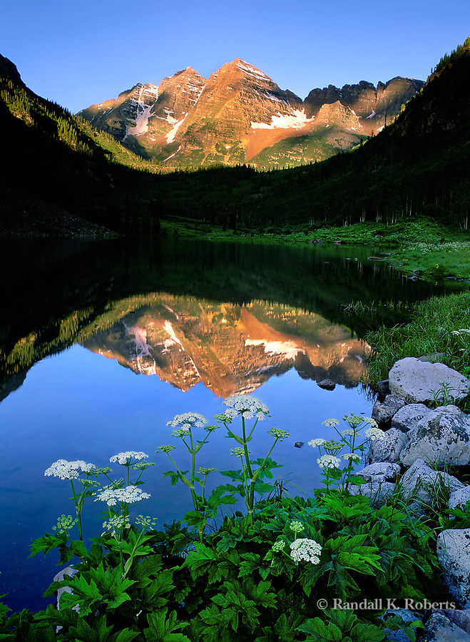 Early morning light on Maroon Bells and Maroon Lake in summer.  Near Aspen, Colorado