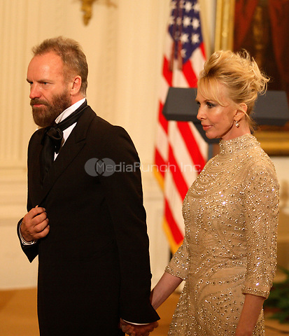 Washington, DC - December 6, 2009 -- Musician Sting and wife, Trudie Styler find their seats prior to a White House East Room reception for the recipients of the 2009 Kennedy Center Honors, in Washington, DC, , Sunday, December 6, 2009.<br /> Credit: Martin H. Simon / Pool via CNP /MediaPunch