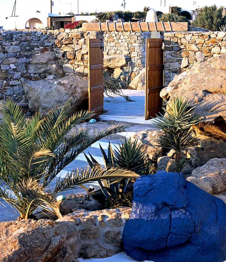 traditional courtyard decorated with a blue rock