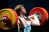 10 MAY 2014 - COVENTRY, GBR - Jack Oliver from the Paul Furness School of Weightlifting attempts to complete a lift during the men's 77kg A category round at the British 2014 Senior Weightlifting Championships and final 2014 Commonwealth Games qualifying event round at the Ricoh Arena in Coventry, Great Britain. Oliver's combined total for the event of 312kg, 32kg over the qualifying standard, makes him eligible for selection for the England team for the Commonwealth Games in Glasgow (PHOTO COPYRIGHT © 2014 NIGEL FARROW, ALL RIGHTS RESERVED)