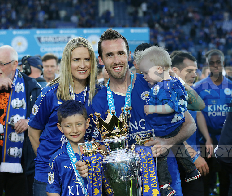 Leicester's Christian Fuchs celebrates with the trophy during the Barclays Premier League match at the King Power Stadium.  Photo credit should read: David Klein/Sportimage