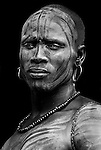 Young Man with face painted, Mursi Tribe, Mago National Park, Lower Omo Valley, Ethiopia, portrait, person, one, tribes, tribal, indigenous, peoples, Southern, ethnic, rural, local, traditional, culture, primitive,.Africa....