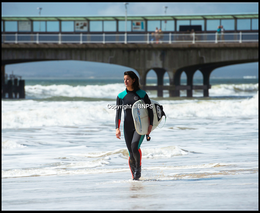 BNPS.co.uk (01202 558833)<br /> Pic: PhilYeomans/BNPS<br /> <br /> Surfers were out.<br /> <br /> Spring has finally arrived on Bournemouth beach today...and it looks like it could be here to stay.