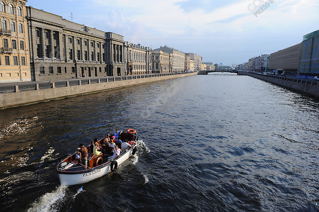 A boat passed along the Fontanka river in the late evening, one of the traditional rites of the White Nights in St. Petersbug. Russia, July 7, 2010