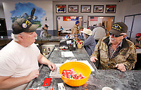 NWA Democrat-Gazette/DAVID GOTTSCHALK Jimmy Cunningham (left) visits with Rick Haney Wednesday, November 7, 2018, during the weekly lunch hour bean dinner in the renovated cantina area at the Shelton Tucker Craft American Legion Post 27 in Fayetteville. Funds raised from the meals go towards operational costs and support the post's outreach efforts.
