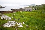 Deserted derelict croft cottage in coastal location at Port Deas an Uidhe, Vatersay Island, Barra, Outer Hebrides, Scotland, UK