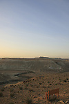 Israel, Northern Negev Mountain. A lone bench in Sde Boker overlooking Zin valley at sunrise