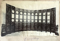 BNPS.co.uk (01202 558833)<br /> Pic: Woolley&Wallis/BNPS<br /> <br /> Victorian photograph of the screen.<br /> <br /> This impressive, giant Chinese screen covered in exquisite porcelain has sold for £75,000.<br /> <br /> The 20ft by 10ft late Qing dynasty-era antique, which can be folded 12 times, would traditionally have been used to divide up large spaces and provide privacy.<br /> <br /> It has hardwood panels bordered by various fruits and flowers with figures of dragons carved into it.<br /> <br /> Attached to the screen are blue and white porcelain plaques showing idyllic landscape scenes.