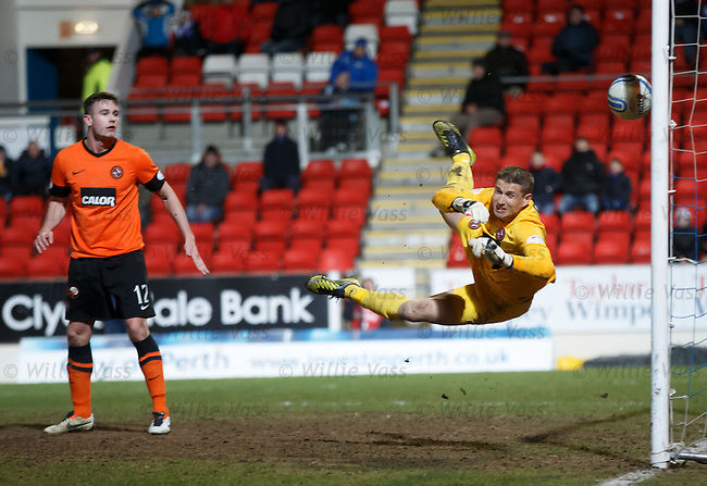 Dundee Utd keeper Radoslaw Cierzniak tips the ball onto the post from  Steven MacLean's header
