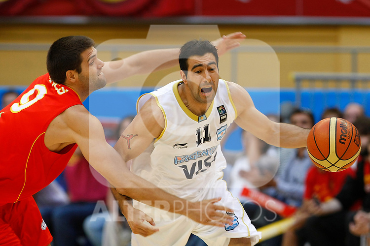 Argentina's Paolo Quinteros (r) and Spain's Felipe Reyes during Friendly match.August, 15, 2010. (ALTERPHOTOS/Acero)