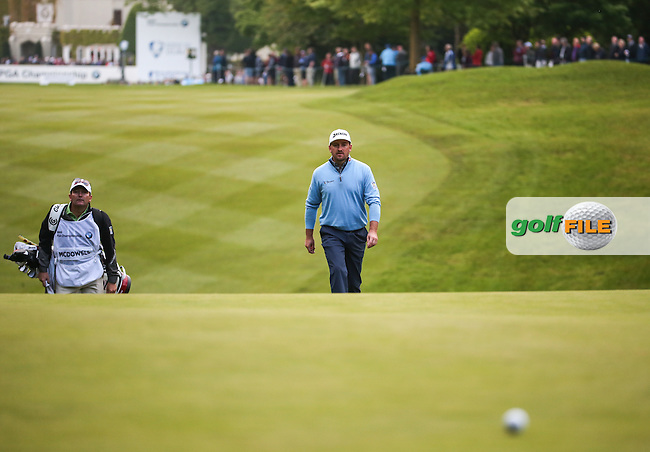 Graeme McDowell (NIR) and caddie Ken Comboy head to the first during Round Two of the 2016 BMW PGA Championship over the West Course at Wentworth, Virginia Water, London. 27/05/2016. Picture: Golffile | David Lloyd. <br /> <br /> All photo usage must display a mandatory copyright credit to &copy; Golffile | David Lloyd.