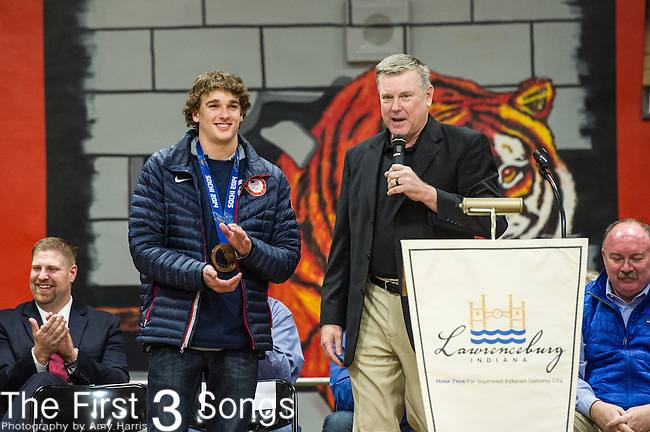 Local sports television personality George Vogel interviews olympic slopestyle bronze medalist Nick Goepper during a parade and celebration in his honor in Lawrenceburg, Indiana.